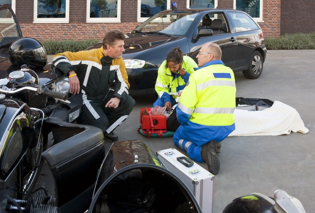 Paramedic helping the injured driver