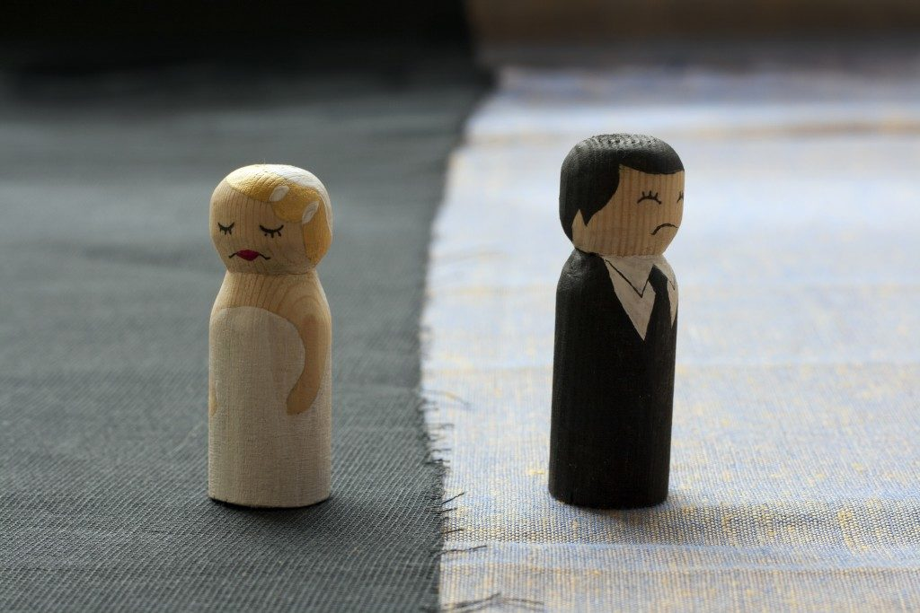 wife and husband small figurines with broken relationship concept