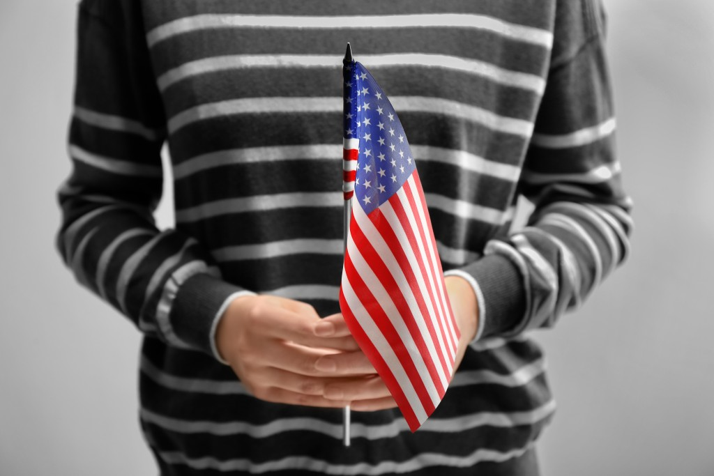 person holding a US flag