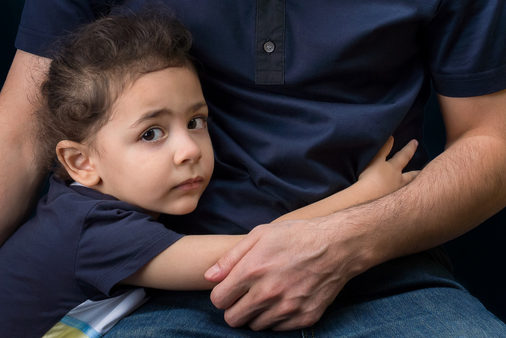 child hugging her dad